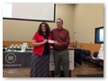 Alexia Johnson presenting Stephen Olsen with scholarship